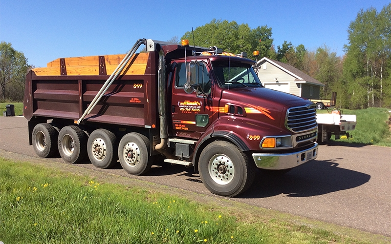 Maroon Jeff Simek Construction Truck